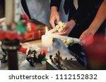 the bride  groom holds in hands ... | Shutterstock . vector #1112152832