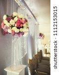 wedding decor  flowers in... | Shutterstock . vector #1112153015