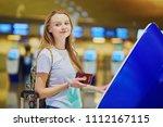 young woman in international...   Shutterstock . vector #1112167115