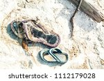 a wasted flip flops on white... | Shutterstock . vector #1112179028