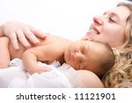 Newborn sleeping child in the hands of mother - stock photo
