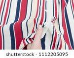 part striped shirt in a female... | Shutterstock . vector #1112205095