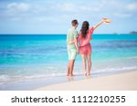 young couple on white beach... | Shutterstock . vector #1112210255