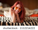 pretty young woman with red... | Shutterstock . vector #1112216222