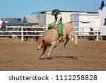 a cowboy competing in the... | Shutterstock . vector #1112258828