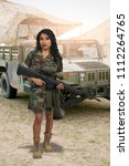 beautiful young woman soldier... | Shutterstock . vector #1112264765