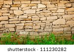 Wall Of Limestone With Grass A...