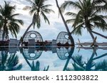 sunset on the the pool  coconut ... | Shutterstock . vector #1112303822