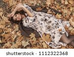 autumn mood. beautiful young... | Shutterstock . vector #1112322368