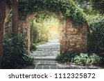stone arch entrance wall with... | Shutterstock . vector #1112325872