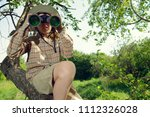 boy exploring nature and the... | Shutterstock . vector #1112326028