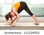 mature woman exercising yoga in