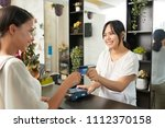 young client giving her credit... | Shutterstock . vector #1112370158