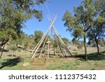 wooden frame of tipi tent | Shutterstock . vector #1112375432