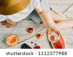 summer picnic setting. woman in ... | Shutterstock . vector #1112377988