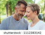 affectionate middle aged couple ... | Shutterstock . vector #1112383142
