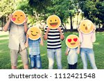happy family holding up emojis | Shutterstock . vector #1112421548