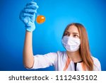 girl in a medical suit holds a ... | Shutterstock . vector #1112435102