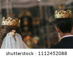 bride and groom standing with... | Shutterstock . vector #1112452088