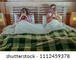 young internet addict couple on ... | Shutterstock . vector #1112459378