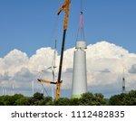 construction of a wind power... | Shutterstock . vector #1112482835