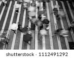 motion blurred pedestrians...   Shutterstock . vector #1112491292