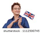 woman holding flag of uk united ... | Shutterstock . vector #1112500745