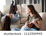 one sister is playing at the... | Shutterstock . vector #1112504945