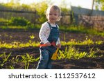baby sitting on the ground with ... | Shutterstock . vector #1112537612