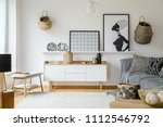 posters and plates above wooden ... | Shutterstock . vector #1112546792