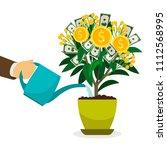 hand watering money tree in... | Shutterstock . vector #1112568995