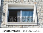 window with rolling shutters ... | Shutterstock . vector #1112573618