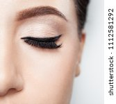 Small photo of daily make-up with powdery shadows and black hands, long curling black, ennobled eyelashes