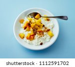 rice pudding with peach | Shutterstock . vector #1112591702