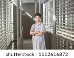 doctor with stethoscope around... | Shutterstock . vector #1112616872