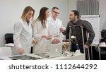 smiling doctors giving pills to ... | Shutterstock . vector #1112644292