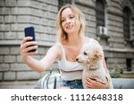 young woman making selfie of... | Shutterstock . vector #1112648318