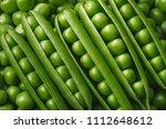 green pea pods texture. natural ... | Shutterstock . vector #1112648612