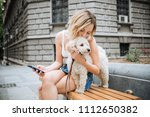 young woman with pet dog... | Shutterstock . vector #1112650382