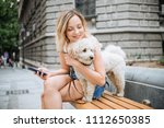 young woman with pet dog... | Shutterstock . vector #1112650385