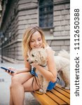 young woman with pet dog... | Shutterstock . vector #1112650388