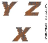 Y  Z  X  Letters Of Brown Color....