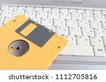floppy disk and laptop | Shutterstock . vector #1112705816