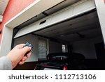 garage door pvc. hand use... | Shutterstock . vector #1112713106