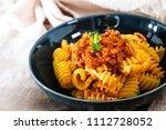 radiatori pasta bolognese on... | Shutterstock . vector #1112728052