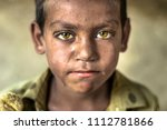 closeup of a poor staring...   Shutterstock . vector #1112781866