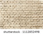 old beige brick wall background ... | Shutterstock . vector #1112852498