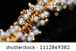 macro of white pearl with... | Shutterstock . vector #1112869382