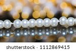 white pearl necklace for... | Shutterstock . vector #1112869415