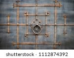 the fragment of forged metal... | Shutterstock . vector #1112874392